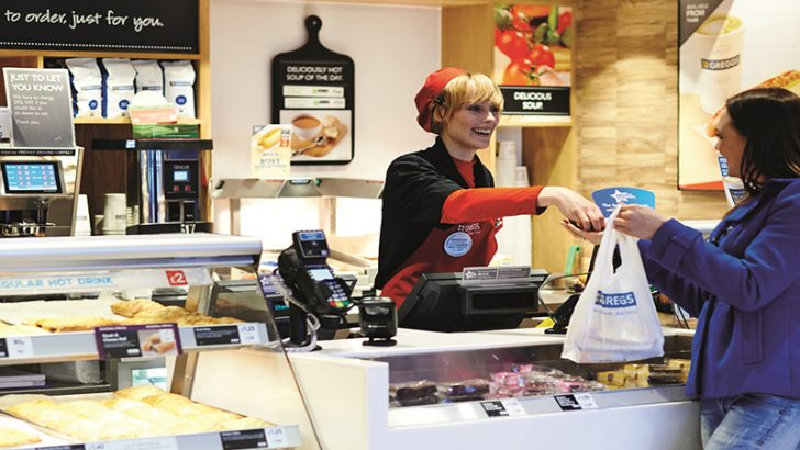 Greggs team member with customer in Bolton Shop