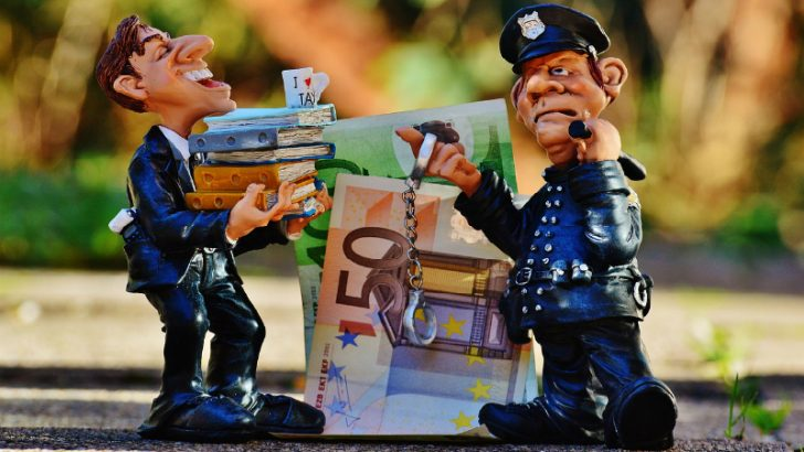 Tax compliance - taxes-tax-evasion-police-handcuffs-1060138/ (Image credit : Pixabay/Alexas_Fotos)